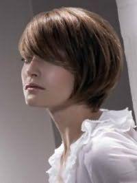 Женская стрижка каре с челкой для круглого лица и русых волос